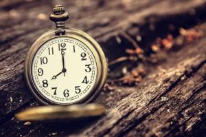 vintage pocket watch on grunge wood log