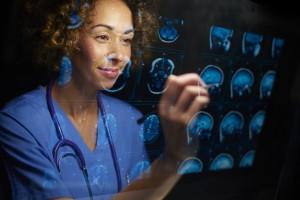 surgeon with mri scans